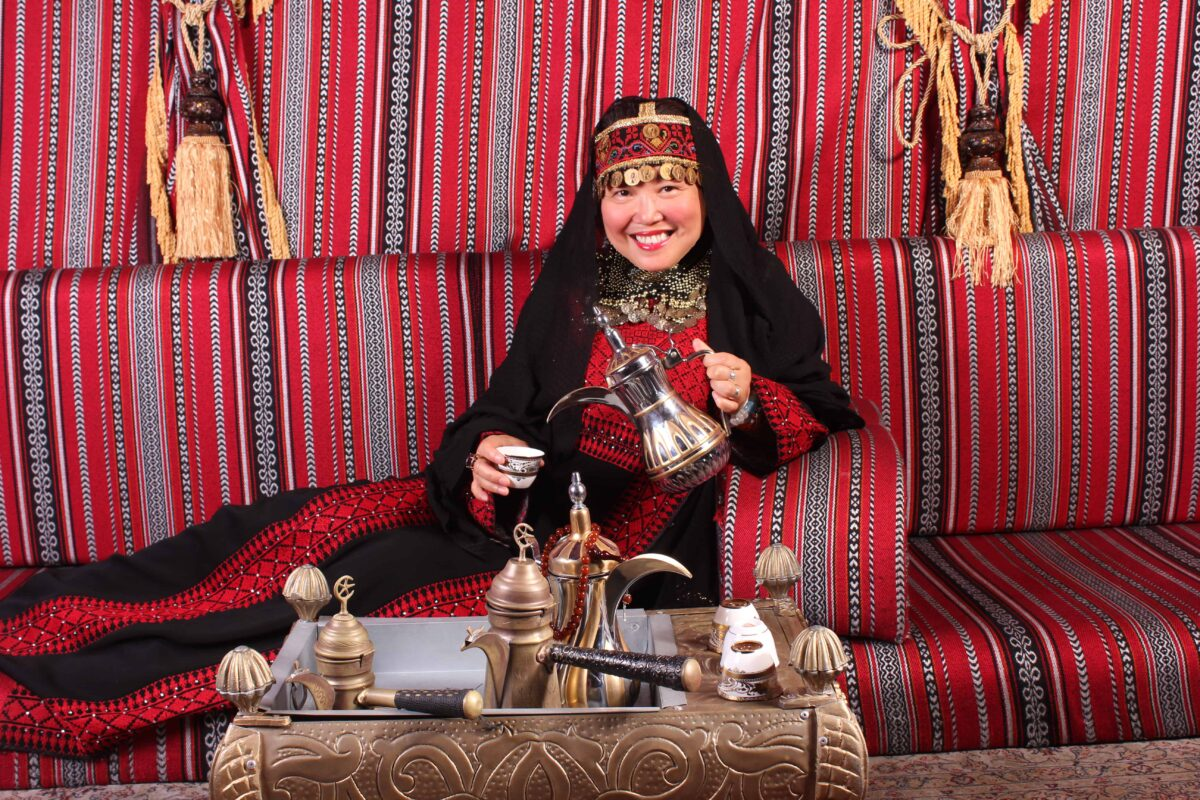 DR ZENAIDY CASTRO IN PALESTINIAN OUTFIT V2